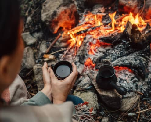 Woman Contemplates Midlife Round Campfire